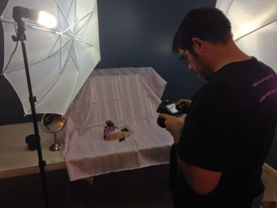 Jeff Goss taking product photographs for Beeyoutiful.com